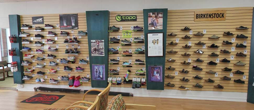 Shoes on display wall inside Foot Dynamics store